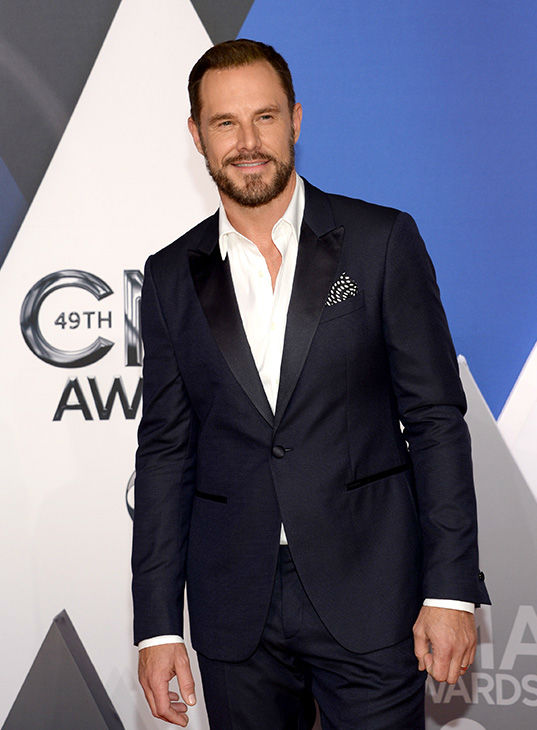 <div class='meta'><div class='origin-logo' data-origin='none'></div><span class='caption-text' data-credit='Evan Agostini/Invision/AP'>Jimi Westbrook, of Little Big Town, arrives at the 49th annual CMA Awards at the Bridgestone Arena on Wednesday, Nov. 4, 2015, in Nashville, Tenn.</span></div>
