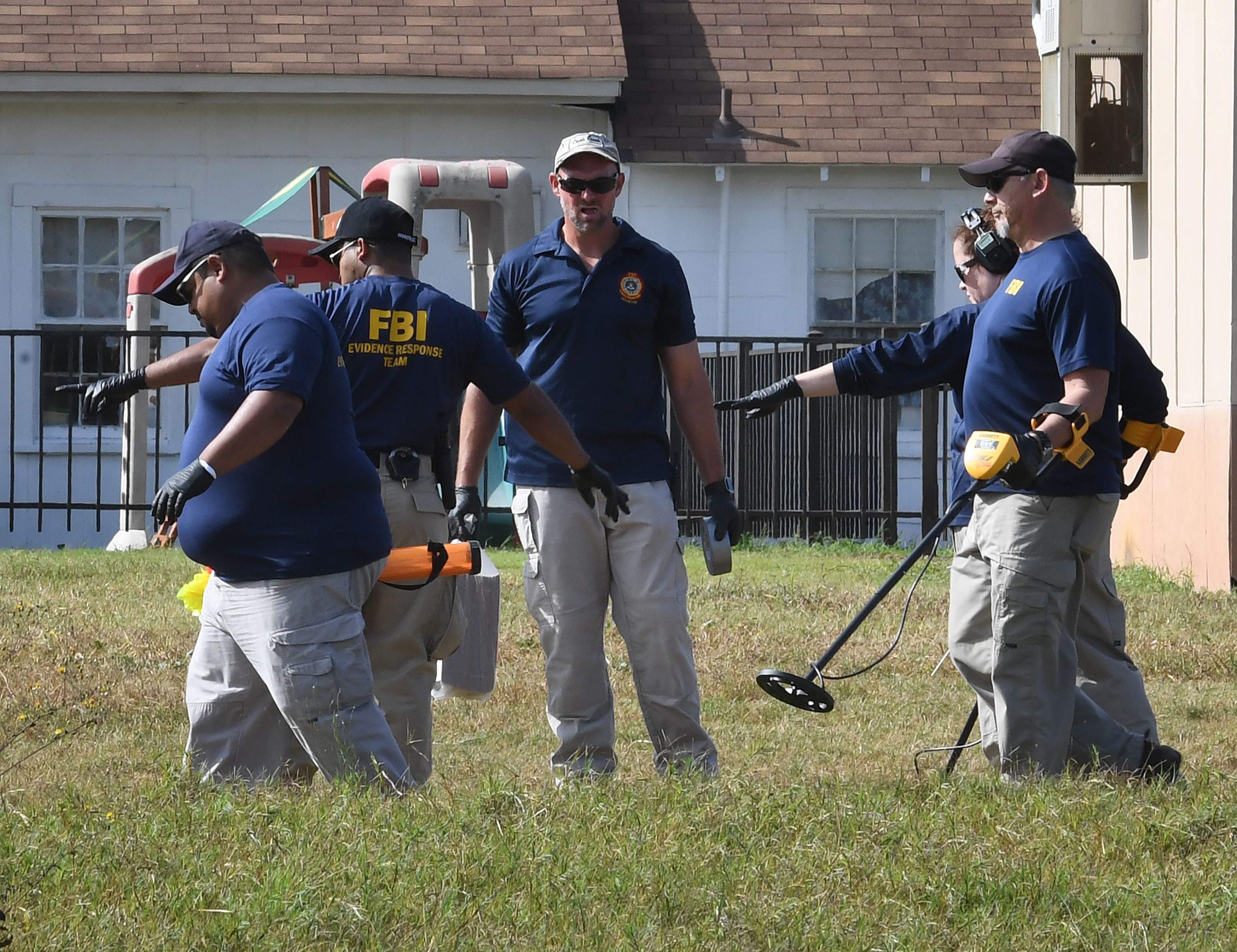 <div class='meta'><div class='origin-logo' data-origin='none'></div><span class='caption-text' data-credit='MARK RALSTON/AFP/Getty Images'>FBI agents search for clues at the entrance to the First Baptist Church, after a mass shooting that killed 26 people in Sutherland Springs, Texas on November 6, 2017.</span></div>