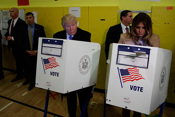 <div class='meta'><div class='origin-logo' data-origin='none'></div><span class='caption-text' data-credit='Evan Vucci/AP Photo'>Republican presidential candidate Donald Trump and his wife Melania, casts their ballots at PS-59, Tuesday, Nov. 8, 2016, in New York.</span></div>