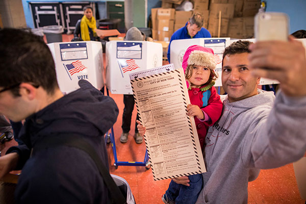 <div class='meta'><div class='origin-logo' data-origin='none'></div><span class='caption-text' data-credit='Alexander F. Yuan/AP Photo'>A man takes a selfie with his child as he waits to vote at a polling station in the Brooklyn borough of New York, Tuesday, Nov. 8, 2016.</span></div>