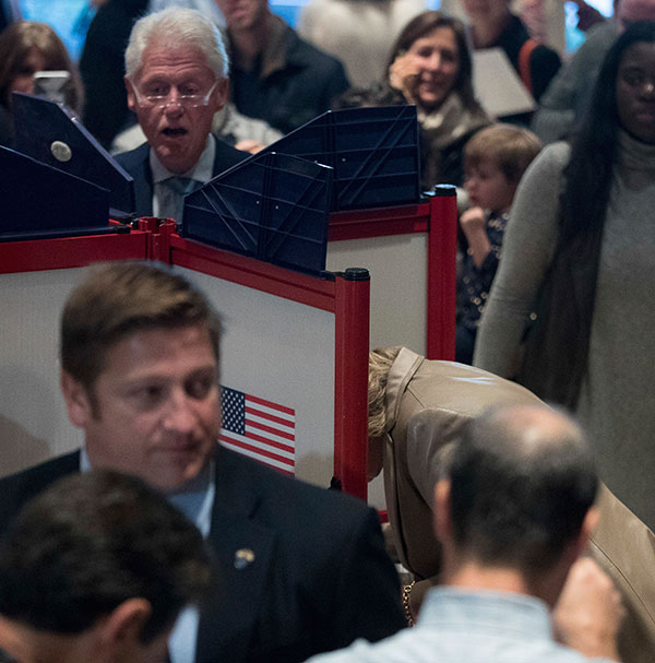 <div class='meta'><div class='origin-logo' data-origin='none'></div><span class='caption-text' data-credit='Andrew Harnik/AP Photo'>Democratic presidential candidate Hillary Clinton, bottom right, accompanied by her husband, former President Bill Clinton, top left, votes in Chappaqua, N.Y. on Tuesday.</span></div>