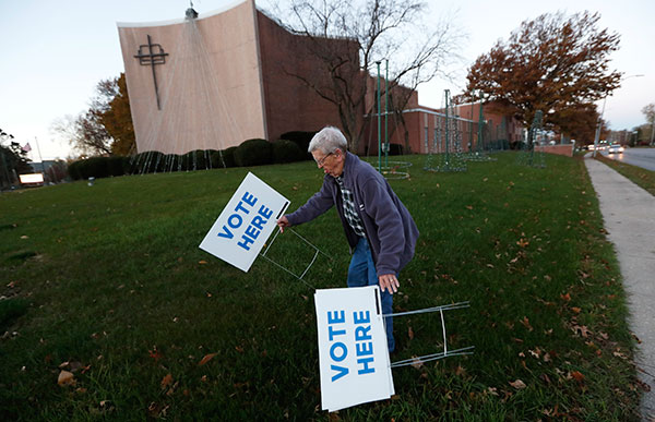 <div class='meta'><div class='origin-logo' data-origin='none'></div><span class='caption-text' data-credit='Charlie Neibergall/AP Photo'>Precinct volunteer Roy Reese puts up signs outside of precinct 39 at the First Church of the Open Bible, Tuesday, Nov. 8, 2016, in Des Moines, Iowa.</span></div>