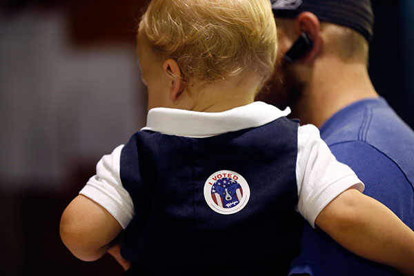 <div class='meta'><div class='origin-logo' data-origin='none'></div><span class='caption-text' data-credit='Gerald Herbert/AP Photo'>Ethan Deshotel, 19 months, sports an &#34;I voted&#34; sticker after his father A.J. Deshotel voted at St. Dominic's School in the Lakeview section of New Orleans on Tuesday.</span></div>