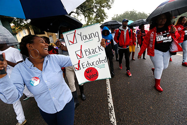 <div class='meta'><div class='origin-logo' data-origin='none'></div><span class='caption-text' data-credit='Gerald Herbert/AP Photo'>Mariah Hickman, a Dillard University student march in unison with fellow students, to a polling place to vote on election day in New Orleans, Tuesday, Nov. 8, 2016.</span></div>
