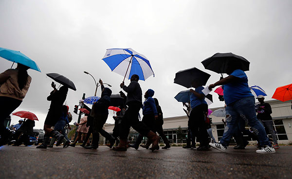 <div class='meta'><div class='origin-logo' data-origin='none'></div><span class='caption-text' data-credit='Gerald Herbert/AP Photo'>Dillard University students march in unison to a polling place to vote on election day in New Orleans, Tuesday, Nov. 8, 2016.</span></div>