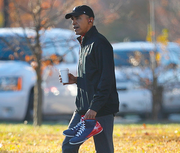 "<div class=""meta image-caption""><div class=""origin-logo origin-image none""><span>none</span></div><span class=""caption-text"">President Barack Obama, wearing his Chicago White Sox baseball cap, and carrying a pair of sneakers, arrives for a private game of basketball, an Election Day tradition for him. (Pablo Martinez Monsivais/AP Photo)</span></div>"