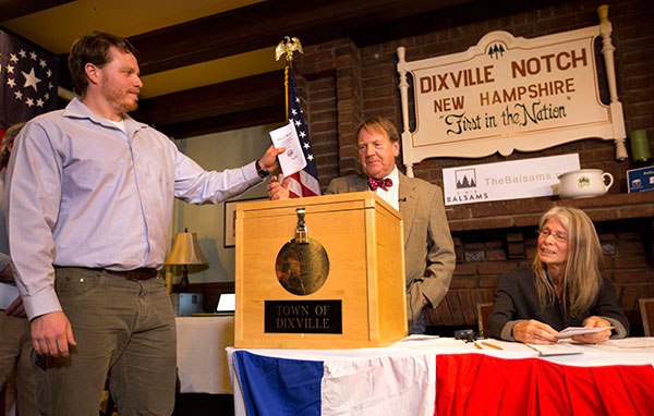 <div class='meta'><div class='origin-logo' data-origin='none'></div><span class='caption-text' data-credit='Jim Cole/AP Photo'>Dixville Notch's first voter Clay Smith drops his ballot into the box as moderator Tom Tillotson watches Tuesday, Nov. 8, 2016, in Dixville Notch, N.H.</span></div>