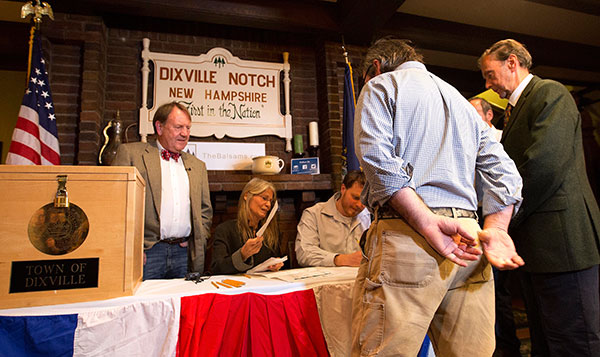 <div class='meta'><div class='origin-logo' data-origin='none'></div><span class='caption-text' data-credit='Jim Cole/AP Photo'>Voters in Dixville Notch, N.H., get their ballots Tuesday, Nov. 8, 2016, in Dixville Notch, N.H. The residents in town voted just after midnight.</span></div>