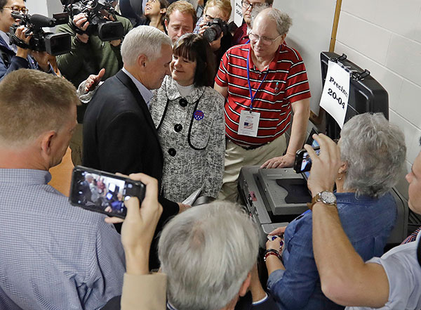 <div class='meta'><div class='origin-logo' data-origin='none'></div><span class='caption-text' data-credit='Darron Cummings/AP Photo'>Republican vice presidential candidate, Indiana Gov. Mike Pence, with his wife Karen, casts his ballot, Tuesday, Nov. 8, 2016, in Indianapolis.</span></div>