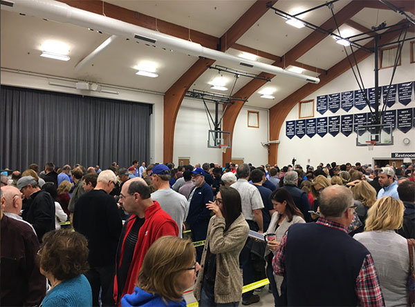 <div class='meta'><div class='origin-logo' data-origin='none'></div><span class='caption-text' data-credit='CGerrity/Twitter'>The crowd inside a polling place is shown in Fishers, Ind., on Tuesday morning.</span></div>