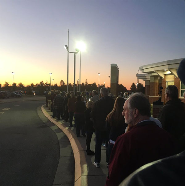 <div class='meta'><div class='origin-logo' data-origin='none'></div><span class='caption-text' data-credit='Randy Garver/Twitter'>Randy Garver in Chesapeake, Va., shared this photo of people lined up to vote early on Tuesday.</span></div>