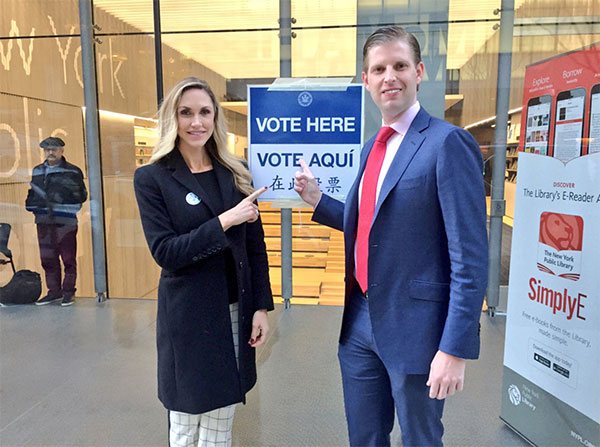 <div class='meta'><div class='origin-logo' data-origin='none'></div><span class='caption-text' data-credit='Lara Trump/Twitter'>Donald Trump's son Eric (right) and Eric's wife Lara (left) pose at their polling place on Tuesday morning.</span></div>