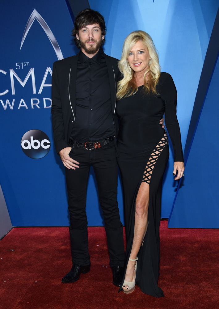 "<div class=""meta image-caption""><div class=""origin-logo origin-image none""><span>none</span></div><span class=""caption-text"">Chris Janson, left, and Kelly Lynn arrive at the 51st annual CMA Awards on Wednesday, Nov. 8, 2017, in Nashville, Tenn. (Evan Agostini/Invision/AP)</span></div>"