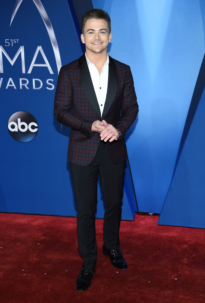 "<div class=""meta image-caption""><div class=""origin-logo origin-image none""><span>none</span></div><span class=""caption-text"">Hunter Hayes arrives at the 51st annual CMA Awards on Wednesday, Nov. 8, 2017, in Nashville, Tenn. (Evan Agostini/Invision/AP)</span></div>"