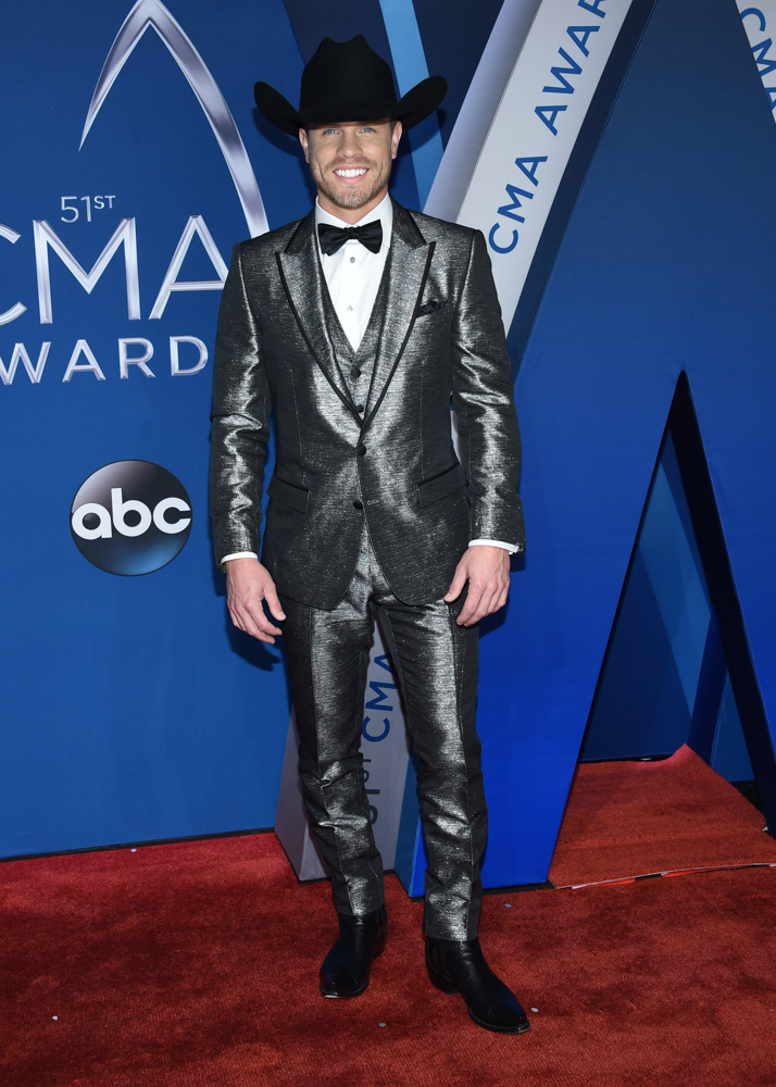 "<div class=""meta image-caption""><div class=""origin-logo origin-image none""><span>none</span></div><span class=""caption-text"">Dustin Lynch arrives at the 51st annual CMA Awards on Wednesday, Nov. 8, 2017, in Nashville, Tenn. (Evan Agostini/Invision/AP)</span></div>"