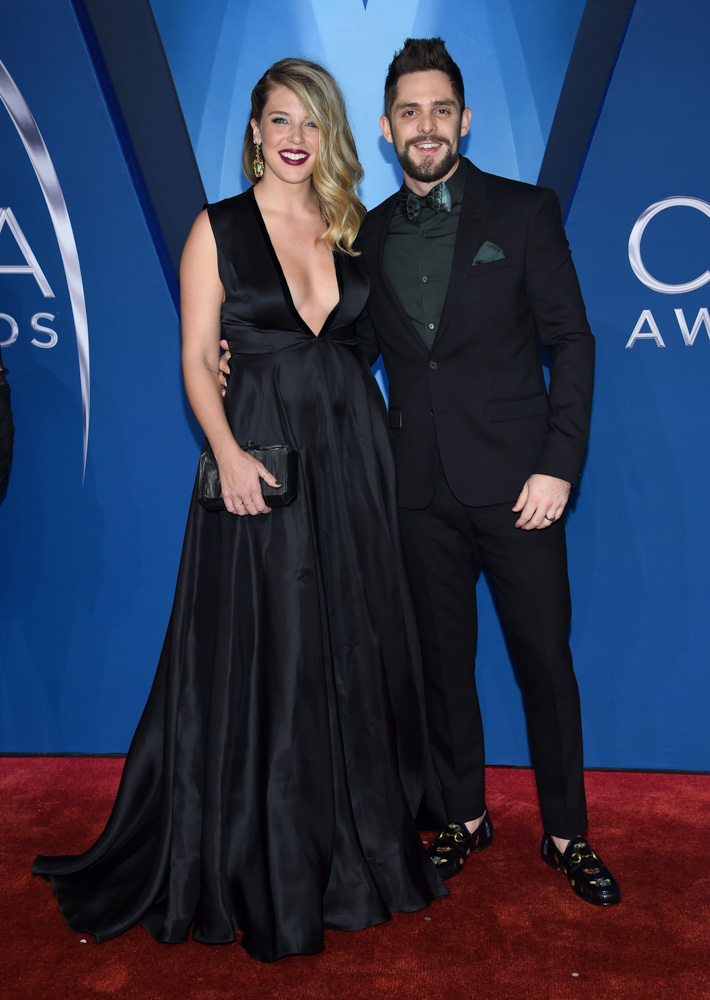 "<div class=""meta image-caption""><div class=""origin-logo origin-image none""><span>none</span></div><span class=""caption-text"">Lauren Akins, left, and Thomas Rhett arrive at the 51st annual CMA Awards on Wednesday, Nov. 8, 2017, in Nashville, Tenn. (Evan Agostini/Invision/AP)</span></div>"
