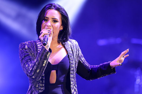 <div class='meta'><div class='origin-logo' data-origin='none'></div><span class='caption-text' data-credit='Rich Fury/Invision/AP'>Demi Lovato, whose fifth album ''CONFIDENT'' dropped in October, will perform on the AMAs for the first time.</span></div>