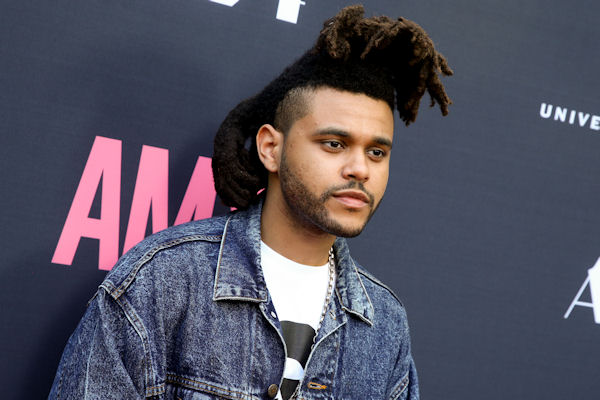 <div class='meta'><div class='origin-logo' data-origin='none'></div><span class='caption-text' data-credit='Rich Fury/Invision/AP'>First-time nominee Abel Tesfaye, known by his stage name the Weeknd, will debut his hit song ''The Hills.''</span></div>