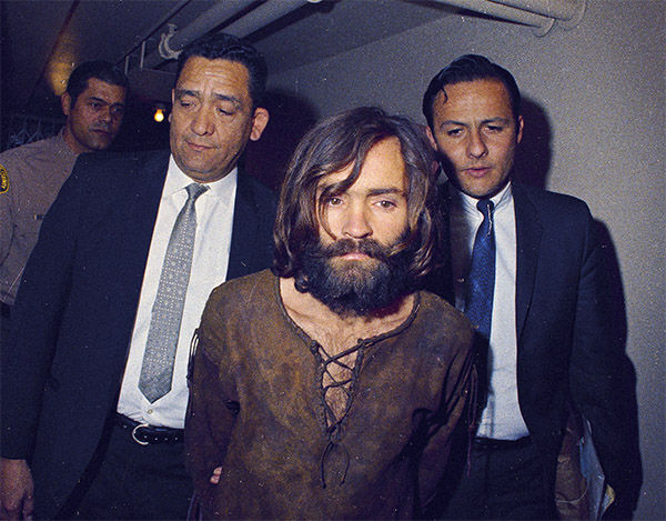 <div class='meta'><div class='origin-logo' data-origin='none'></div><span class='caption-text' data-credit='Photo/AP'>Charles Manson is escorted to his arraignment on conspiracy-murder charges in conneciton with the Sharon Tate murder case, 1969, Los Angeles, Calif.</span></div>