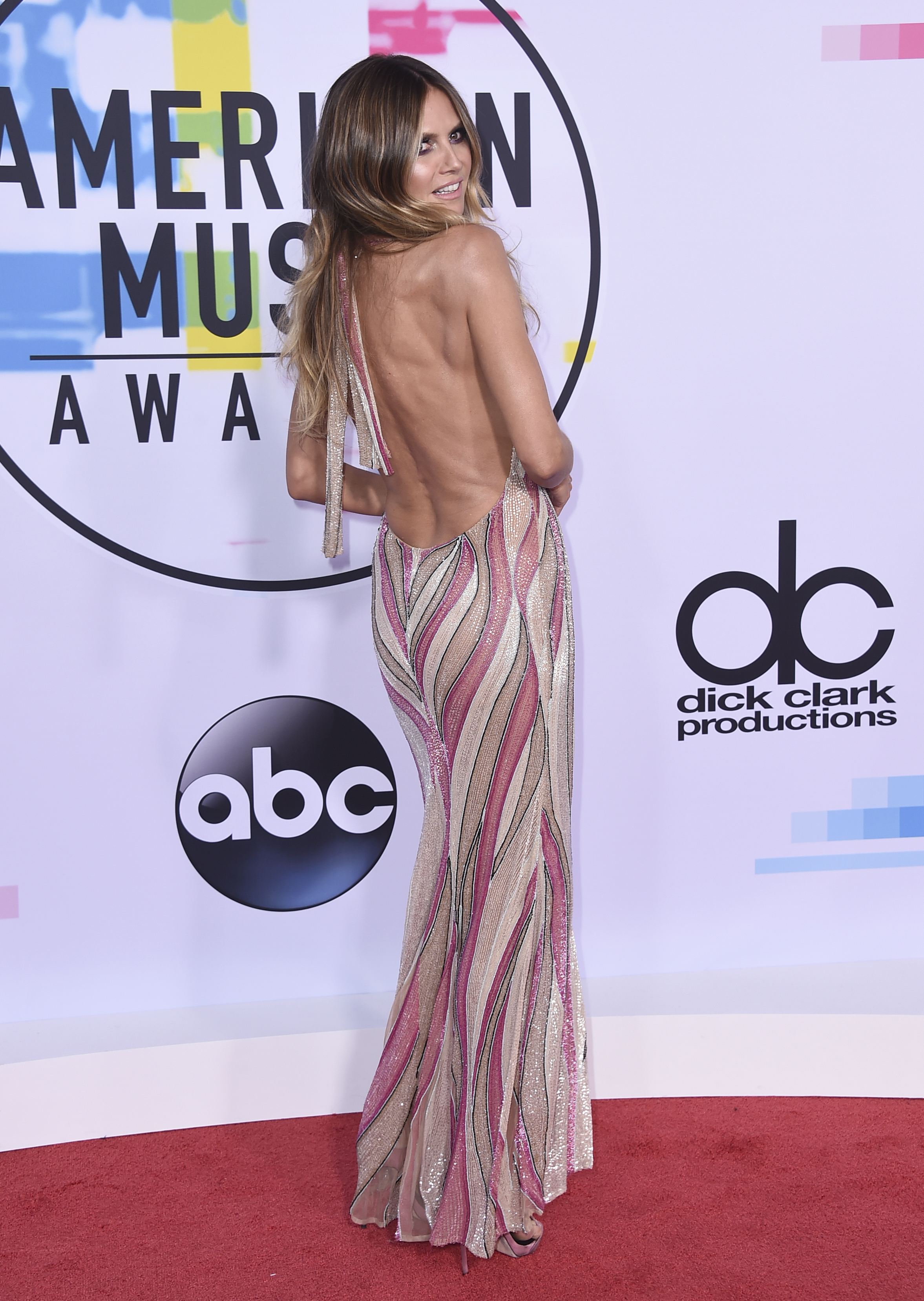 <div class='meta'><div class='origin-logo' data-origin='none'></div><span class='caption-text' data-credit='Jordan Strauss/Invision/AP'>Heidi Klum arrives at the American Music Awards at the Microsoft Theater on Sunday, Nov. 19, 2017, in Los Angeles.</span></div>