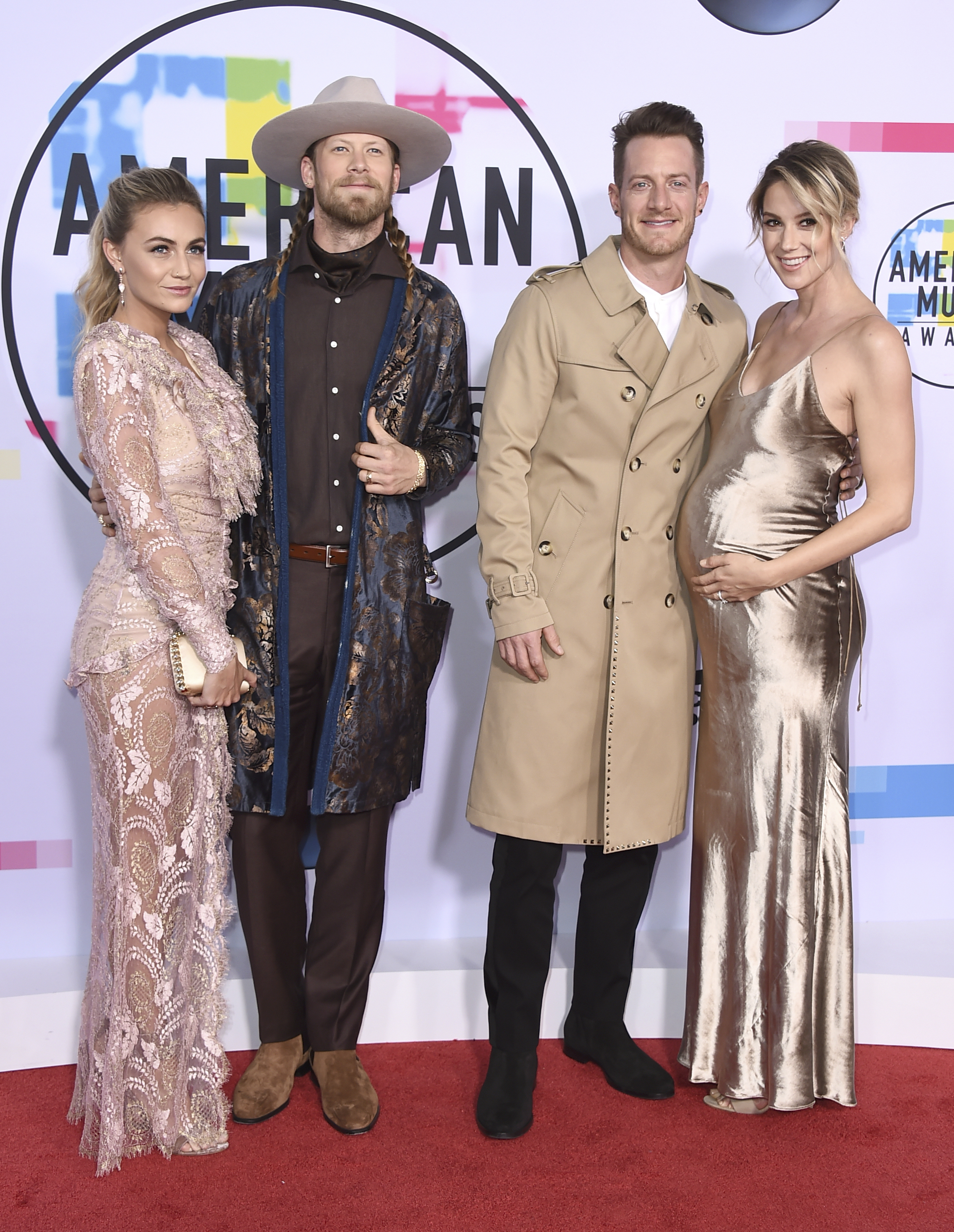 <div class='meta'><div class='origin-logo' data-origin='none'></div><span class='caption-text' data-credit='Jordan Strauss/Invision/AP'>Brittney Marie Cole, from left, Brian Kelley and Tyler Hubbard of Florida Georgia Line, and Hayley Hubbard arrive at the American Music Awards at the Microsoft Theater.</span></div>
