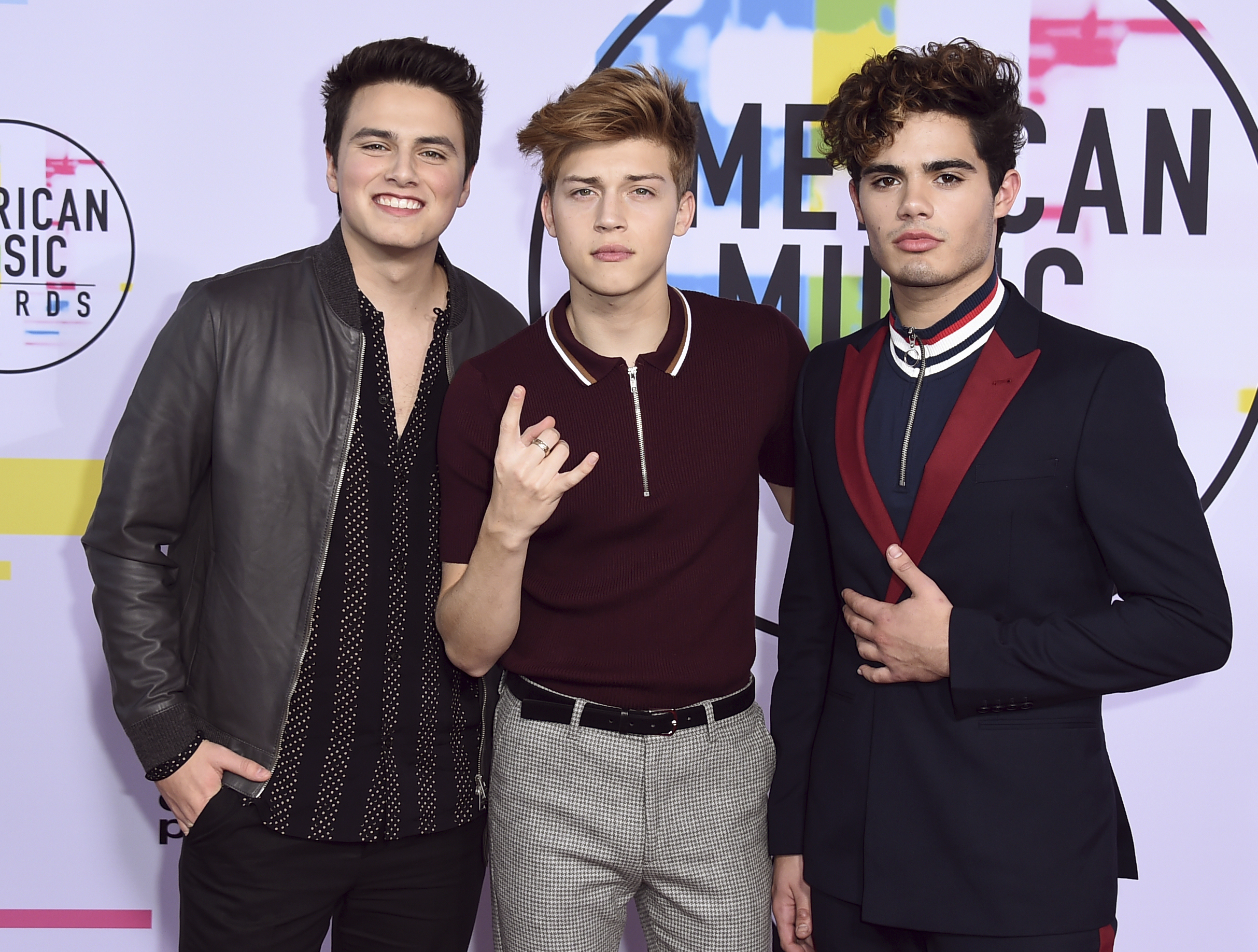 <div class='meta'><div class='origin-logo' data-origin='none'></div><span class='caption-text' data-credit='Jordan Strauss/Invision/AP'>Liam Attridge, from left, Ricky Garcia, and Emery Kelly of Forever in Your Mind arrive at the American Music Awards at the Microsoft Theater.</span></div>