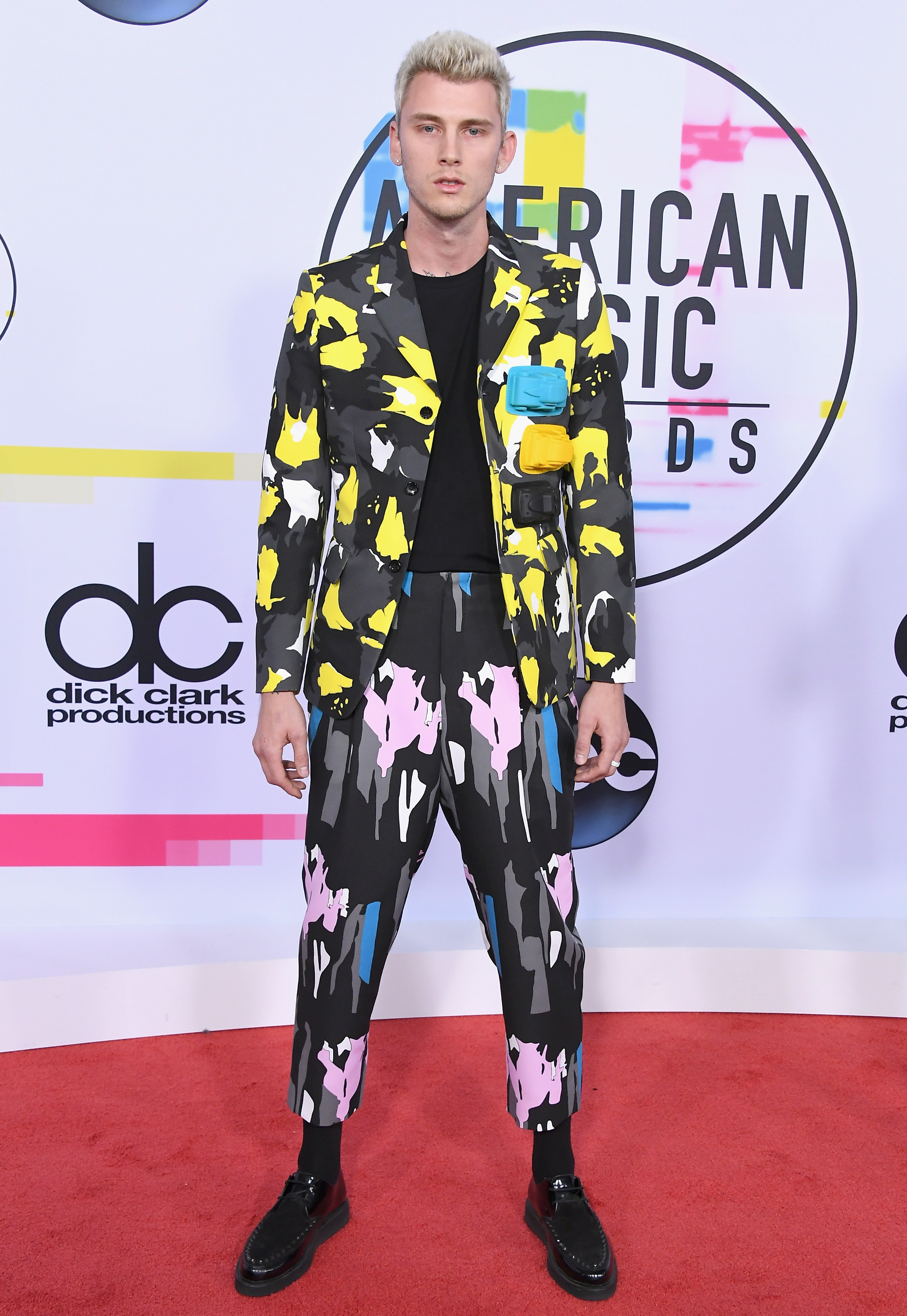 <div class='meta'><div class='origin-logo' data-origin='none'></div><span class='caption-text' data-credit='Steve Granitz/WireImage via Getty'>Machine Gun Kelly attends the 2017 American Music Awards at Microsoft Theater on November 19, 2017 in Los Angeles, California.  (Photo by Steve Granitz/WireImage)</span></div>