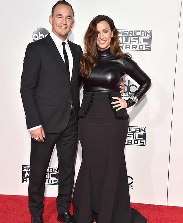<div class='meta'><div class='origin-logo' data-origin='AP'></div><span class='caption-text' data-credit='Jordan Strauss/Invision/AP'>Souleye, left, and Alanis Morissette arrive at the American Music Awards at the Microsoft Theater on Sunday, Nov. 22, 2015, in Los Angeles.</span></div>