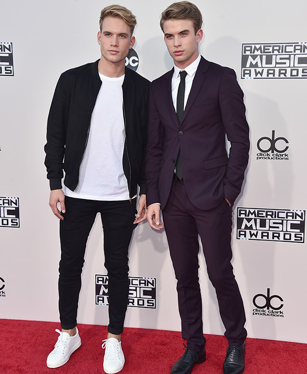 <div class='meta'><div class='origin-logo' data-origin='AP'></div><span class='caption-text' data-credit='Jordan Strauss/Invision/AP'>Austin Rhodes, left, and Aaron Rhodes arrive at the American Music Awards at the Microsoft Theater on Sunday, Nov. 22, 2015, in Los Angeles.</span></div>