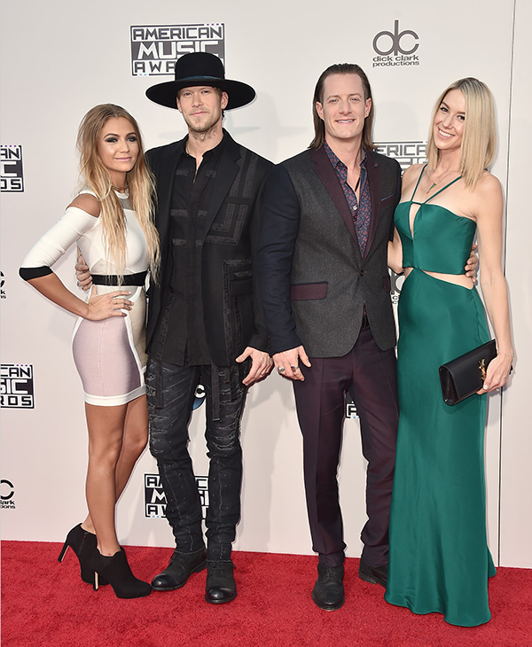 <div class='meta'><div class='origin-logo' data-origin='AP'></div><span class='caption-text' data-credit='Jordan Strauss/Invision/AP'>Brittney Marie Cole, from left, Brian Kelley and Tyler Hubbard from Florida Georgia Line, and Hayley Stommel arrive at the American Music Awards.</span></div>