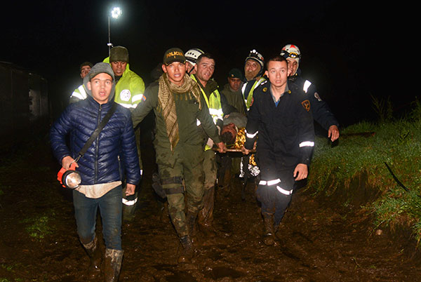 <div class='meta'><div class='origin-logo' data-origin='none'></div><span class='caption-text' data-credit='Luis Benavides/AP Photo'>Rescue workers carry the body of a survivor on Tuesday, Nov. 29, 2016, after a plane crashed in La Union, a mountainous area outside Medellin, Colombia.</span></div>