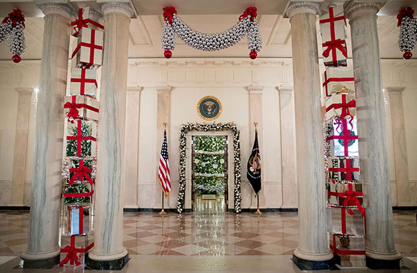 <div class='meta'><div class='origin-logo' data-origin='none'></div><span class='caption-text' data-credit='Andrew Harnik/AP Photo'>This year's White House Christmas Tree is seen inside the Blue Room from the Cross Hall of the White House during a preview of the 2015 holiday decor at the White House.</span></div>