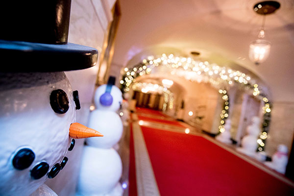<div class='meta'><div class='origin-logo' data-origin='none'></div><span class='caption-text' data-credit='Andrew Harnik/AP Photo'>The Lower Cross Hall is decorated with &#34;snowball&#34; arches created from more than 6,000 ornaments and snowmen lining the corridor in the White House.</span></div>