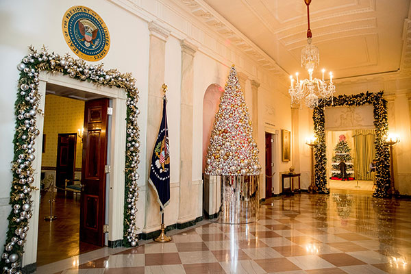 <div class='meta'><div class='origin-logo' data-origin='none'></div><span class='caption-text' data-credit='Andrew Harnik/AP Photo'>The Cross Hall is decorated at the White House during a preview of the 2016 holiday decor, Tuesday, Nov. 29, 2016, in Washington.</span></div>