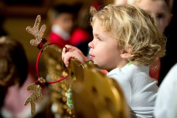 <div class='meta'><div class='origin-logo' data-origin='none'></div><span class='caption-text' data-credit='Andrew Harnik/AP Photo'>A child holds reindeer antlers while waiting for First lady Michelle Obama to arrive in the East Room of the White House Nov. 29, 2016.</span></div>