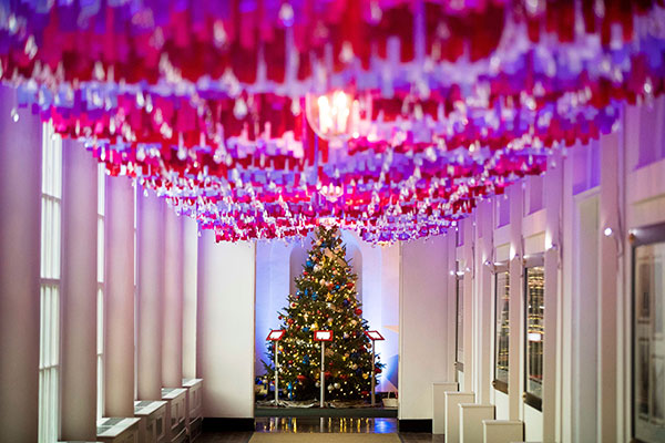 <div class='meta'><div class='origin-logo' data-origin='none'></div><span class='caption-text' data-credit='Andrew Harnik/AP Photo'>More than 7,500 strands of colored ribbon hang with with sparkling crystal ornaments on the East Colonnade of the White House during a preview of the 2016 holiday decor.</span></div>