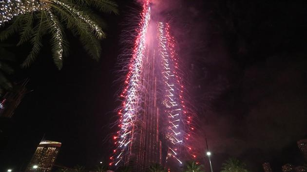 <div class='meta'><div class='origin-logo' data-origin='~ORIGIN~'></div><span class='caption-text' data-credit='AP Photo/Jon Gambrell'>Fireworks illuminate the Burj Khalifa as a tower burns behind it, lower right of tower, in Dubai, United Arab Emirates on Friday, Jan. 1, 2016.</span></div>