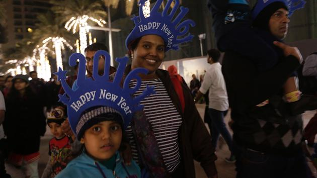 <div class='meta'><div class='origin-logo' data-origin='~ORIGIN~'></div><span class='caption-text' data-credit='AP Photo/Sunday Alamba'>Passers-by smile during New Year celebrations in Dubai, United Arab Emirates on Friday, Jan. 1, 2016.</span></div>