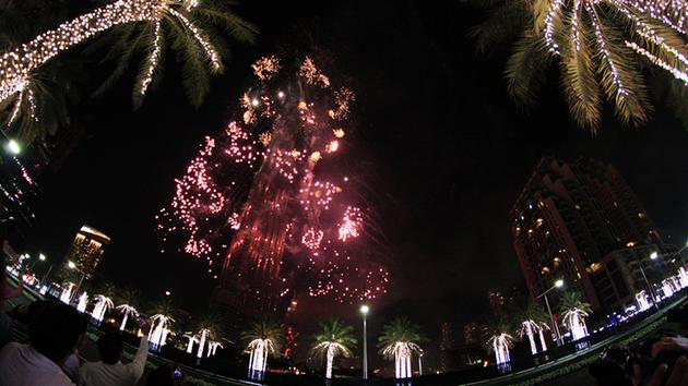 <div class='meta'><div class='origin-logo' data-origin='~ORIGIN~'></div><span class='caption-text' data-credit='AP Photo/Jon Gambrell'>Fireworks illuminate the Burj Khalifa as a tower burns behind it in Dubai, United Arab Emirates on Friday, Jan. 1, 2016.</span></div>