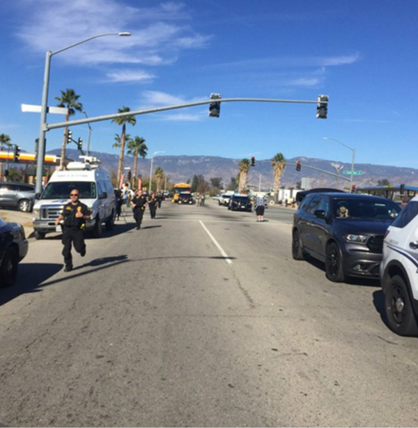 <div class='meta'><div class='origin-logo' data-origin='none'></div><span class='caption-text' data-credit='mattgutmanABC/Twitter'>Armed officials still rushing toward scene of San Bernardino shooting.</span></div>
