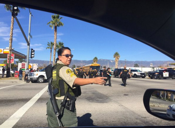 <div class='meta'><div class='origin-logo' data-origin='none'></div><span class='caption-text' data-credit='mattgutmanABC/Twitter'>Armed officials unloading in San Bernardino.</span></div>