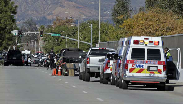 <div class='meta'><div class='origin-logo' data-origin='none'></div><span class='caption-text' data-credit='AP Photo/ Chris Carlson'>Law enforcement members line up near the the site of a mass shooting on Wednesday, Dec. 2, 2015 in San Bernardino, Calif.</span></div>
