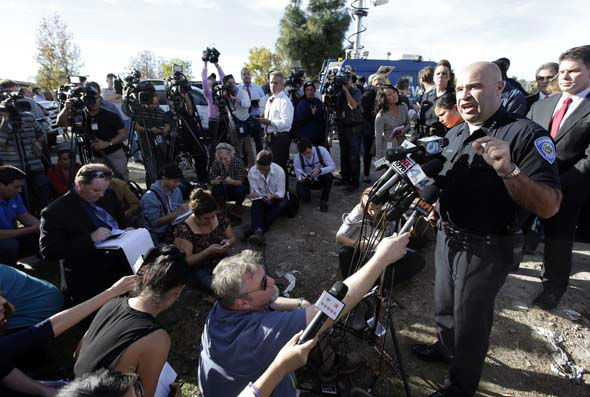 <div class='meta'><div class='origin-logo' data-origin='none'></div><span class='caption-text' data-credit='AP Photo/ Chris Carlson'>San Bernardino Police Chief Jarrod Burguan, right, talks to the media near the the site of a mass shooting on  Wednesday, Dec. 2, 2015, in San Bernardino, Calif.</span></div>