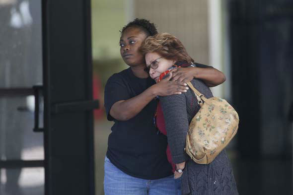 <div class='meta'><div class='origin-logo' data-origin='none'></div><span class='caption-text' data-credit='AP Photo/ Jae C. Hong'>Two women embrace at a community center where family members are gathering to pick up survivors after a shooting rampage at a social services center in San Bernardino, Calif.</span></div>