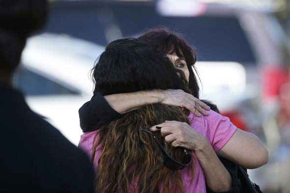 <div class='meta'><div class='origin-logo' data-origin='none'></div><span class='caption-text' data-credit='AP Photo/ Jae C. Hong'>Teresa Hernandez, facing camera, is comforted by a woman as she arrives at a social services center in San Bernardino, Calif.</span></div>
