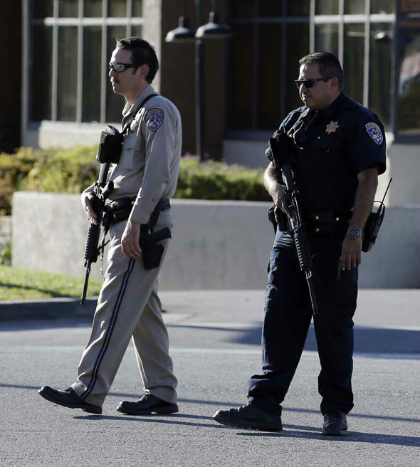 <div class='meta'><div class='origin-logo' data-origin='none'></div><span class='caption-text' data-credit='AP Photo/ Chris Carlson'>Law enforcement officers block a street near the site of a mass shooting that killed multiple people at a social services center in San Bernardino, Calif.</span></div>