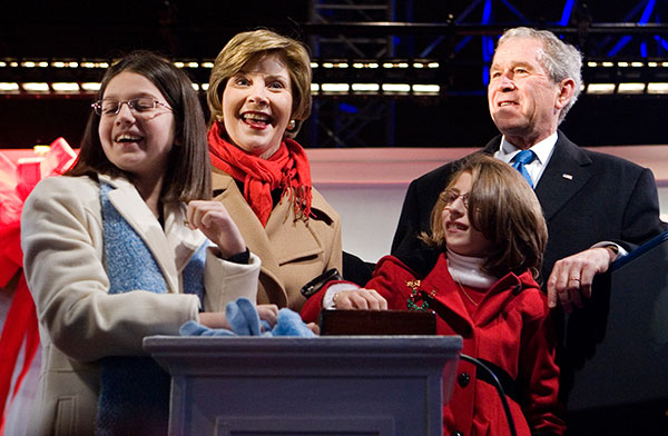 "<div class=""meta image-caption""><div class=""origin-logo origin-image none""><span>none</span></div><span class=""caption-text"">President George W. Bush and first lady Laura Bush are joined by Lindsey Van Horn, left, and Kayleigh Kepler, right, during the lighting ceremony on Dec. 4, 2008. (Haraz N. Ghanbari/AP Photo)</span></div>"