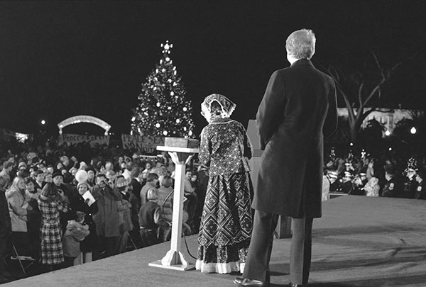 "<div class=""meta image-caption""><div class=""origin-logo origin-image none""><span>none</span></div><span class=""caption-text"">Amy Carter stands with President Jimmy Carter on a stage at the Ellipse in Washington Thursday, Dec. 16, 1977, after he pushed a button illuminating the National Christmas Tree. (AP Photo)</span></div>"