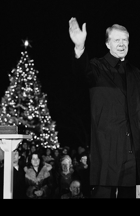 "<div class=""meta image-caption""><div class=""origin-logo origin-image none""><span>none</span></div><span class=""caption-text"">President Jimmy Carter waves after he and his daughter Amy pressed the button that turned on the lights of the National Christmas Tree on Dec. 15, 1978. (Ira Schwarz/AP Photo)</span></div>"