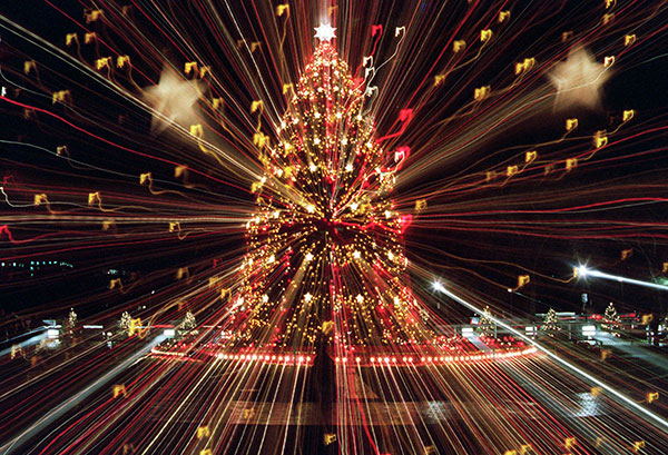"<div class=""meta image-caption""><div class=""origin-logo origin-image none""><span>none</span></div><span class=""caption-text"">The National Christmas Tree shines brightly Thursday, Dec. 7, 1995 on the Ellipse in Washington. A zoom lens technique was used to produce this photograph. (Mark Wilson/AP Photo)</span></div>"